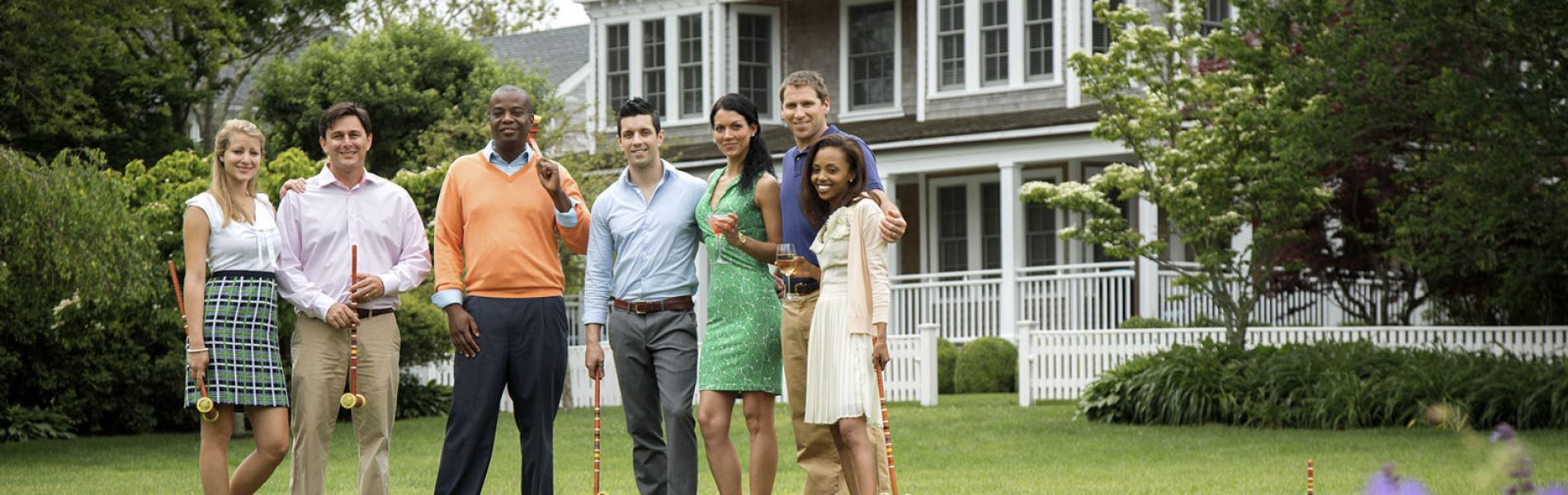 A Group Of People Standing In A Yard